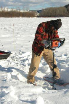 Stankievech boring through the Yukon River ice (photo www.stankievech.net/projects/DEW/pixels/construct13.html)